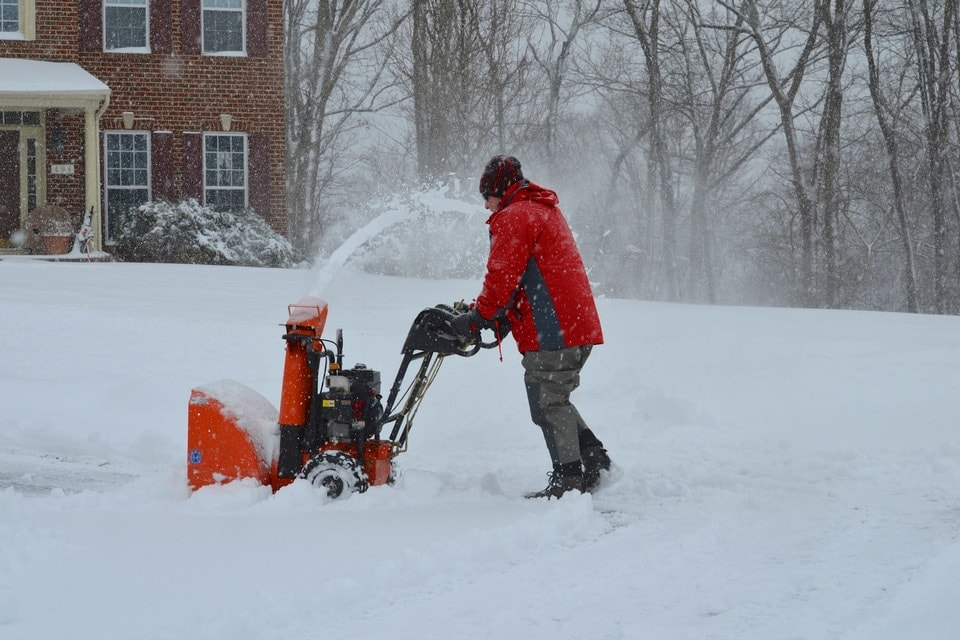 Person with a snow blower