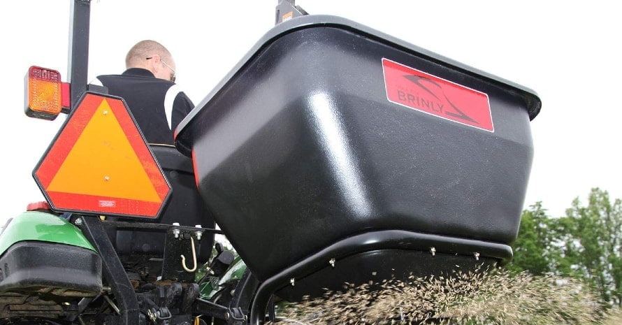 Brinly BS36BH broadcast spreader in use